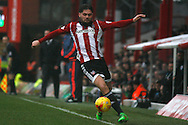 Ryan Woods of Brentford trying to keep the ball in play . Skybet football league championship match, Brentford  v Derby county at Griffin Park in London on Saturday 20th February 2016.<br /> pic by Steffan Bowen, Andrew Orchard sports photography.