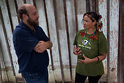 Male Brazilian journalist talking to Sheyla Juruana - leader of the tribe. A third of Altamira in the state of Para, Brazil will be flooded to make way for the Belo Monte dam, nearly all the people affected are the poorest in society or indigenous communities that will have nowhere to go if they were made homeless, and the Government payoff for their properties is low therefore making it difficult to find new accomodation. At present, the Arara land is protected from development, sale or new residents as it has been their ancestral land for hundreds of years, this is now one of the key areas under threat