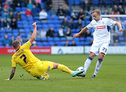 Tranmere Rovers midfielder Matthew Gill (23)is tackled by Plymouth Argyle forward Lewis Alessandra (7) - Photo mandatory by-line: Nigel Pitts-Drake/JMP - Mobile: 07966 386802 11/10/2014 - SPORT - FOOTBALL - Birkenhead - Prenton Park - Tranmere Rovers v Plymouth Argyle - Sky Bet League Two