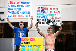 """© Licensed to London News Pictures . 24/06/2017. London, UK. The English Defence League ( EDL ) hold a March on Parliament , from Charing Cross to Victoria Embankment , opposed by  a counter demonstration by Unite Against Fascism . Scotland Yard said it was using public order laws to restrict the marches """"due to concerns of serious public disorder, and disruption to the community"""" following terrorist attacks in Manchester , Westminster and Finsbury Park and the Grenfell Tower fire  . Photo credit: Joel Goodman/LNP"""