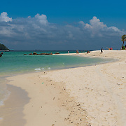 People sunbathing on Koh Lipe beach, Thailand