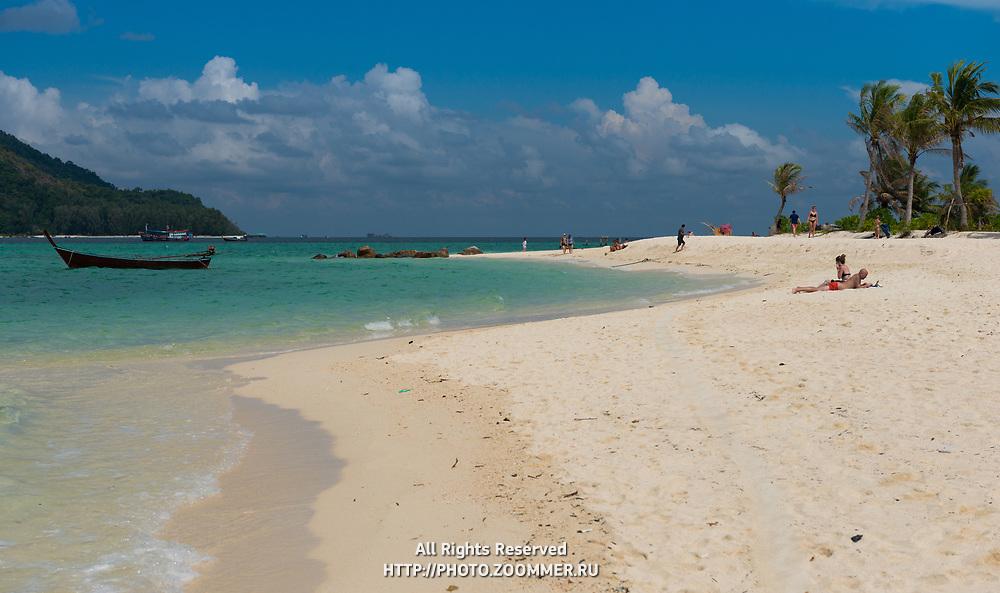 People sunbathing on Koh Lipe beach, Thailand