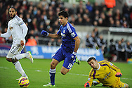 Diego Costa of Chelsea goes past Swansea goalkeeper Lukasz Fabianski but fails to score. Barclays Premier League match, Swansea city v Chelsea at the Liberty Stadium in Swansea, South Wales on Saturday 17th Jan 2015.<br /> pic by Andrew Orchard, Andrew Orchard sports photography.