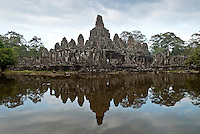 A wide shot of The Bayon temple in the walled city of Angkor Thom, Siem Reap, Cambodia