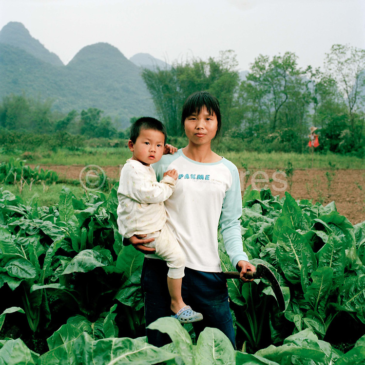 Wei Fengxiu, 28 a farmer lives with her husband (also a farmer) their son, Canxuefeng, two and her parents-in-law in Yan Chun village, Guangxi province, where there they are pictured here. Many women in China go to live with their in-laws when they get married but Wei says many of her friends have problems getting on with their mother-in-law and thinks this is down to the one child policy: pampered only sons and their new wives cause friction...Its over thirty years (1978) since the Mao's Chinese government brought in the One Child Policy in a bid to control the world's biggest, growing population. It has been successful, in controlling growth, but has led to other problems. E.G. a gender in-balance with a projected 30 million to many boys babies; Labour shortages and a lack of care for the elderly.