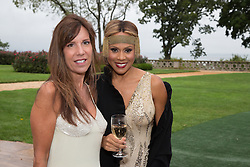 singer Deborah Cox and friend at a wedding reception