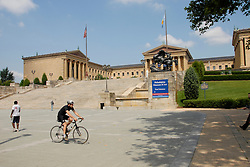 Exterior of Philadelphia Museum of Art, with bicyclist. .Philadelphia, Pennsylvania, PA USA.  Photo copyright Lee Foster, 510-549-2202, lee@fostertravel.com, www.fostertravel.com.  Photo 206-30759_1