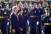 US President Bill Clinton and Chinese Premier Zhu Rongji review the honor guard during the official arrival ceremony at the White House April 8, 1999 in Washington D.C.