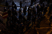 The riot police officers gather at the corner before they start charging towards the protesters during the protest in Mong Kok on September 3rd, 2019 in Hong Kong.