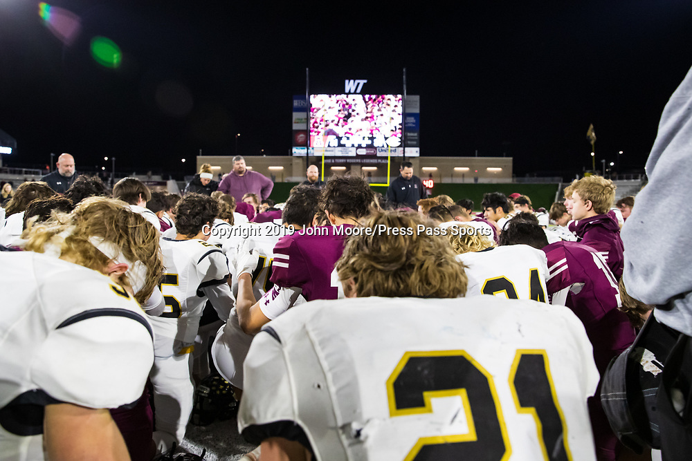 The Abernathy and Canadian players pray after the UIL 3A-D2 Region 1 Championship on Friday, Dec. 6, 2019, at Buffalo Stadium in Canyon, Texas. [Photo by John Moore/Press Pass Sports]