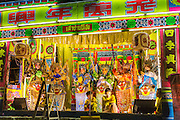 27 APRIL 2013 - BANGKOK, THAILAND:   Performers on stage during a Chinese opera in the Talat Noi neighborhood of Bangkok's Chinatown. Chinese opera was once very popular in Thailand and is usually performed in the Teochew language. Millions of Chinese emigrated to Thailand (then Siam) in the 18th and 19th centuries and brought their cultural practices with them. Recently its popularity has faded as people turn to performances of opera on DVD or movies. There are as many 30 Chinese opera troupes left in Bangkok. They travel from Chinese temple to Chinese temple performing on stages they put up in streets near the temple, sometimes sleeping on hammocks they sling under their stage. The opera troupes are paid by the temple, usually $700 to $1000 a night. PHOTO BY JACK KURTZ