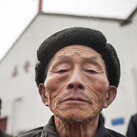A congregant stands outside a government-sanctioned Three-Self Patriotic Movement Protestant church. There are about 57,000 Three-Self Churches in China.