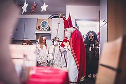 THEMENBILD - Nikolaus mit Engel und Krampus, während eines traditionellen Hausbesuchs der Nikoaus und Krampusgruppe Frieden, aufgenommen am 04. Dezember 2018 in Lienz, Österreich // Home visit from Krampus and Saint Nicholas. Krampus a mythical creature that, according to legend, accompanies Saint Nicholas during the festive season. Instead of giving gifts to good children, he punishes the bad ones, Lienz, Austria on 2018/12/04. EXPA Pictures © 2018, PhotoCredit: EXPA/ JFK