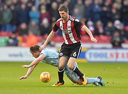 Sheffield United's Chris Basham battles with Sunderland's Lynden Gooch
