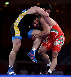 Jakarta, Aug 19,2018  Alireza Karimimachiani (R) of Iran competes during Men's Wrestling Freestyle 97 kg Final against Magomed Musaev of Kyrgyzstan at the 18th Asian Games at Jakarta, Indonesia, Aug. 19, 2018. (Credit Image: © Yue Yuewei/Xinhua via ZUMA Wire)