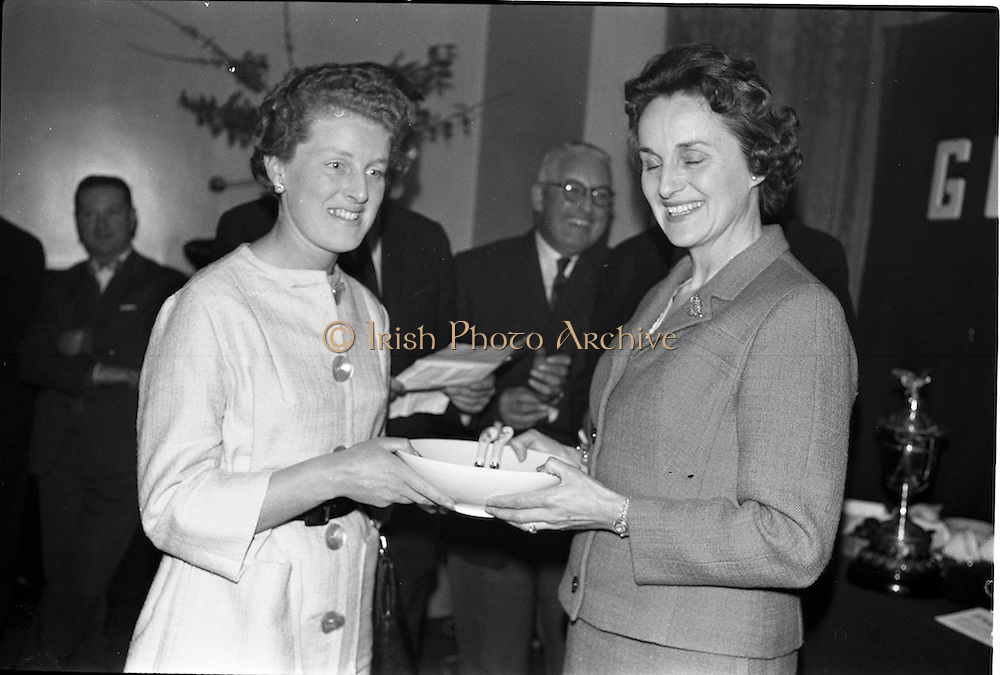 23/05/1963<br /> 05/23/1963<br /> 23 May 1963<br /> Esso Staff Golf Outing at Woodbrook Golf Club, Co. Dublin. Image from the prize giving after the event in the Golf Club. Mrs J. Donovan, wife of Esso Director, John Donovan, on right, presenting the prizes, in this case a bowl.