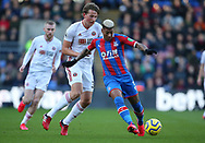 Crystal Palace's Patrick van Aanholt and Sheffield United's Sander Berge during the Premier League match at Selhurst Park, London. Picture date: 1st February 2020. Picture credit should read: Paul Terry/Sportimage