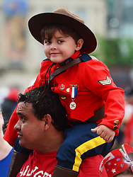 A youngster dressed like a Mountie takes in the Canada 150 celebrations on Parliament Hill in Ottawa on Saturday, July 1, 2017. Photo by Sean Kilpatrick/CP/ABACAPRESS.COM