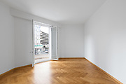 Empty room with white walls and wooden floors