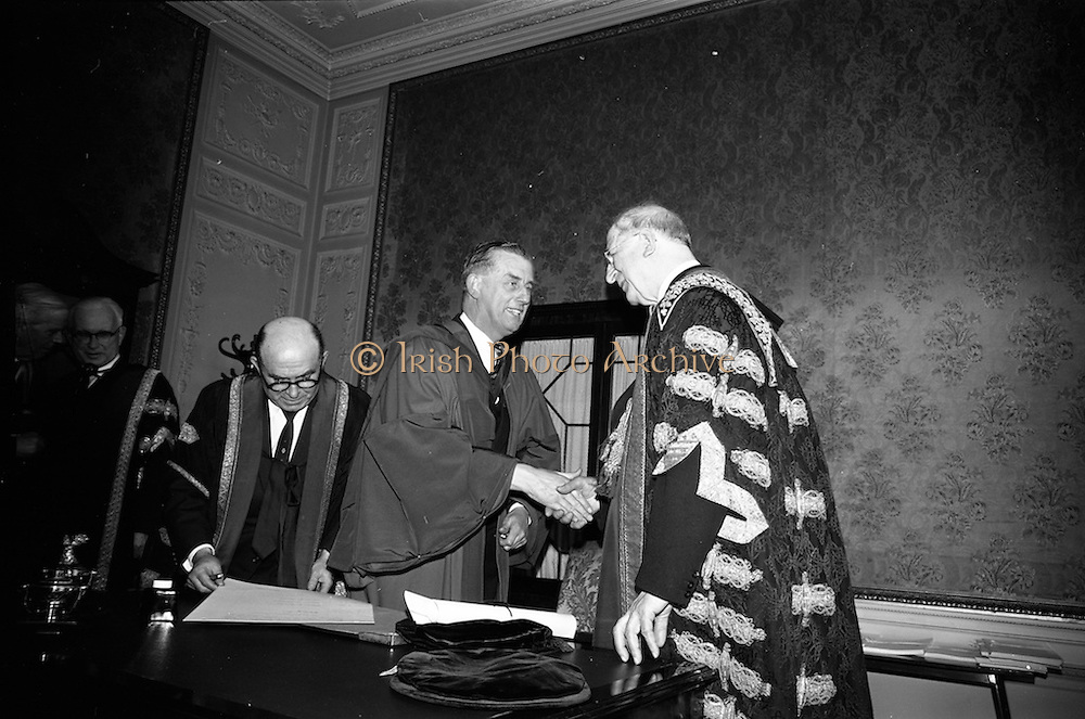 23/04/1964<br /> 04/23/1964<br /> 23 April 1964<br /> Honorary Degrees conferred at the National University of Ireland, Iveagh House, Dublin. <br /> Picture shows President Eamon de Valera (right) Chancellor of the University congratulating Mr J.F. Dempsey, general Manager of Aer Lingus, who received the degree of LL.D. after the ceremony. Dr. Seamus Wilmot, Registar of the University third from right.