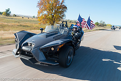 Ernie Turtle Williams of Rapid City, US Army Chemical Corps SSG retired and member of the American Legion Riders Post 164 on his Slingshot for the USS South Dakota submarine flag relay across South Dakota on the first day from Sturgis to Aberdeen. SD. USA. Saturday October 7, 2017. Photography ©2017 Michael Lichter.