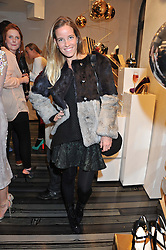 CAROLINA GONZALEZ-BUNSTER at a party to celebrate the launch of a limited edition shoe The Chambord in celebration of Nicholas Kirkwood's partnership with Chambord black raspberry liqueur, held at the Nicholas Kirkwood Boutique, 5 Mount Street, London on 12th December 2012.