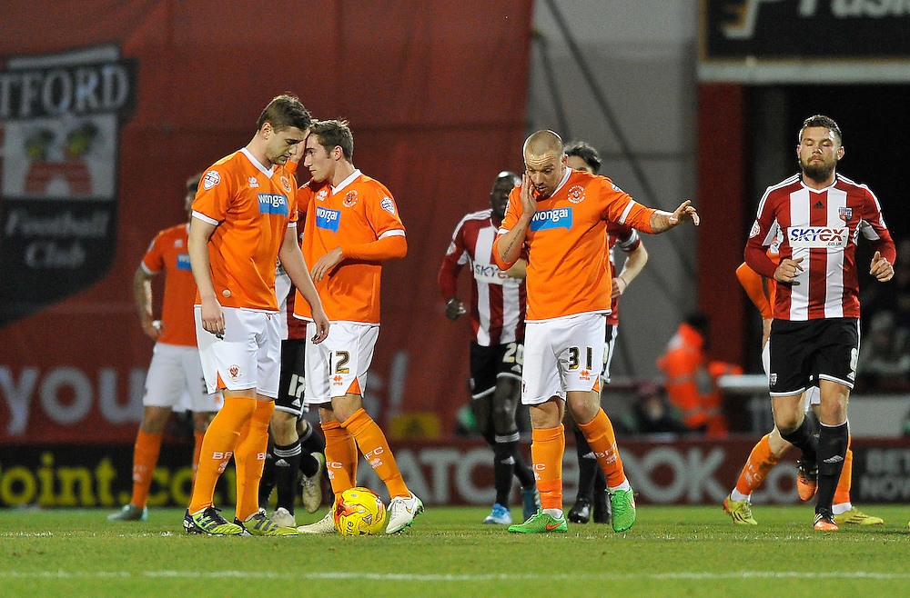 Blackpool players after going behind last night<br /> <br /> Photographer Ashley Western/CameraSport<br /> <br /> Football - The Football League Sky Bet League One - Brentford v Blackpool - Tuesday 24th February 2015 - Griffin Park - London<br /> <br /> © CameraSport - 43 Linden Ave. Countesthorpe. Leicester. England. LE8 5PG - Tel: +44 (0) 116 277 4147 - admin@camerasport.com - www.camerasport.com