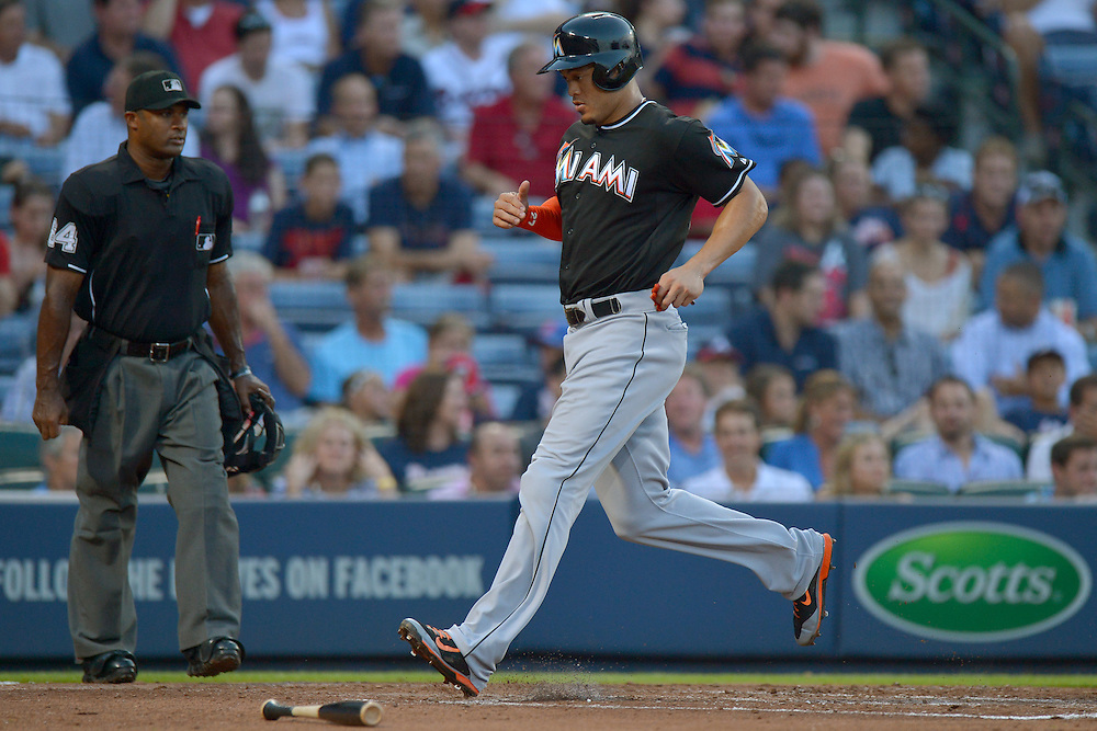 Jul 22, 2014; Atlanta, GA, USA; Miami Marlins right fielder Giancarlo Stanton (27) scores against the Atlanta Braves during the third inning at Turner Field. Mandatory Credit: Kevin Liles-USA TODAY Sports