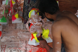 July 29, 2017 - Ajmer, Rajasthan, India - An Indian artist works on an idol of the Hindu deity Ganesh at a workshop. (Credit Image: © Sourabh Vyas/Pacific Press via ZUMA Wire)