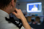 A prison officer watches a training video. HMP Wandsworth, London, United Kingdom