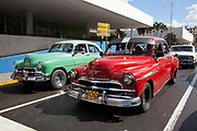 Old Amercian cars in Havana waiting at the traffic lights in Vedado, Havana.