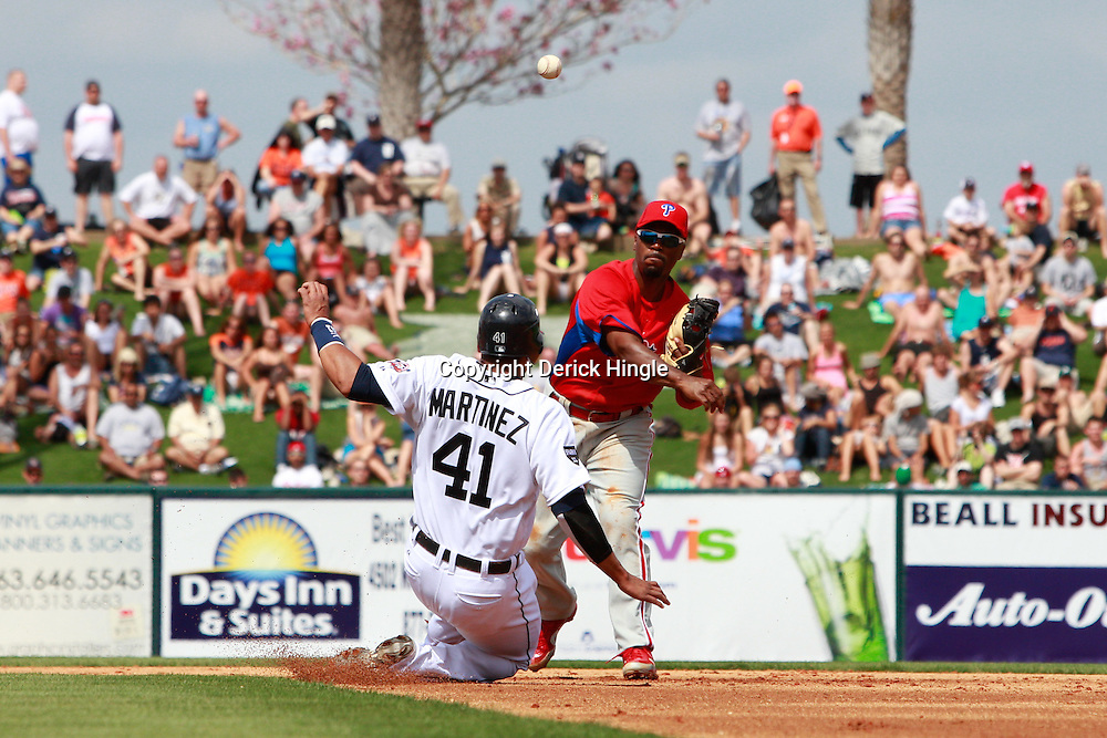 March 9, 2011; Lakeland, FL, USA; Philadelphia Phillies shortstop Jimmy Rollins (11) forces out Detroit Tigers catcher Victor Martinez (41) and completes a double play during a spring training exhibition game at Joker Marchant Stadium.   Mandatory Credit: Derick E. Hingle