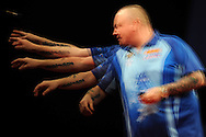 a multiple exposure image created in camera shows Andy Hamilton (Eng) in action in his match against Simon Whitlock (Aus). McCoy's Premier league darts, week 7 event at the Motorpoint Arena in Cardiff, South Wales on Thursday 21st March 2013. pic by Andrew Orchard, Andrew Orchard sports photography,
