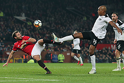 5 January 2018 - FA Cup (3rd Round) Football - Manchester United v Derby County - Juan Mata of Man Utd and Andre Wisdom of Derby stretch for the ball - Photo: Charlotte Wilson / Offside