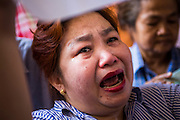 """01 FEBRUARY 2014 - BANGKOK, THAILAND:  A Thai woman cries after she was told she wouldn't be able to vote in Bangkok Sunday. Thais went to the polls in a """"snap election"""" Sunday called in December after Prime Minister Yingluck Shinawatra dissolved the parliament in the face of large anti-government protests in Bangkok. The anti-government opposition, led by the People's Democratic Reform Committee (PDRC), called for a boycott of the election and threatened to disrupt voting. Many polling places in Bangkok were closed by protestors who blocked access to the polls or distribution of ballots. The result of the election are likely to be contested in the Thai Constitutional Court and may be invalidated because there won't be quorum in the Thai parliament.   PHOTO BY JACK KURTZ"""