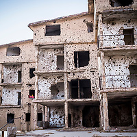 Towels hang in the window of a bombed out bulding in eastern Lebanon in October 2016. Many such ruined buildings —deserted legacies of the 15-year long Lebanese civil war — became adhoc homes for Syrian refugees, fleeing the civil war in neighbouring Syria. Lebanon officially accepted 1.7 million Syrian refugees.