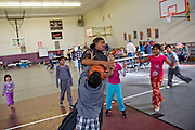 24 JANUARY 2010 -- WENDEN, AZ: People from Wenden play a pick up game of basketball in the shelter in Salome. Wenden was slammed by its second 100 year flood in 10 years on Thursday night when water raced through Centennial Wash and into the small town in La Paz County west of Phoenix. Most of the town's residents were evacuated to Red Cross shelters in Salome, about 5 miles west of Wenden.   PHOTO BY JACK KURTZ