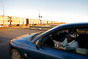 A couple of aboriginal waiting for the passage of a train carrying iron ore in Port Hedland.