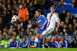 Chelsea Midfielder Eden Hazard (BEL) passes under pressure from Basel Midfielder Fabian Frei (SUI) during the first half of the match - Photo mandatory by-line: Rogan Thomson/JMP - Tel: 07966 386802 - 18/09/2013 - SPORT - FOOTBALL - Stamford Bridge, London - Chelsea v FC Basel - UEFA Champions League Group E