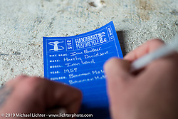 Filling in the Blueprint bike entry form on Friday before the grand opening that evening of the Handbuilt Motorcycle Show. Austin, TX. April 10, 2015.  Photography ©2015 Michael Lichter.