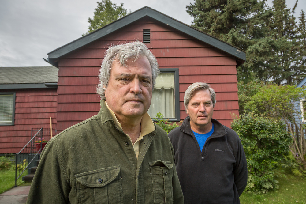 """""""We've always wanted to fix this place up...but it's a slow process.""""  -Brothers George and David Freeman stand in front of their home in Anchorage, Alaska."""