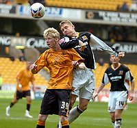 Photo: Ed Godden/Sportsbeat Images.<br />Wolverhampton Wanderers v Hull City. Coca Cola Championship. 09/04/2007. Wolves' Andy Keogh (L), battles with Andy Dawson.