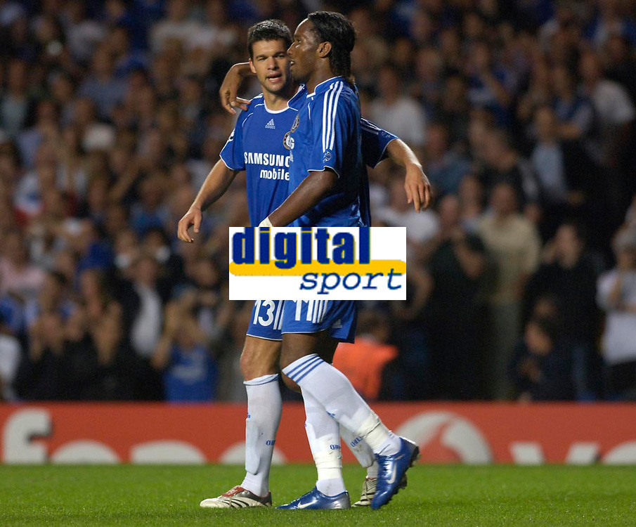 Photo: Daniel Hambury.<br />Chelsea v Werder Bremen. UEFA Champions League, Group A. 12/09/2006.<br />Chelsea's Michael Ballack celebrates scoring from the spo with Didier Drogba who won the penalty.