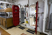 """Crew mess below decks of USS Missouri. Ordered in 1940 and active in June 1944, the USS Missouri (""""Mighty Mo"""") was the last battleship commissioned by the United States. She is best remembered as the site of the surrender of the Empire of Japan which ended World War II on September 2, 1945 in Tokyo Bay. In the Pacific Theater of World War II, she fought in the battles of Iwo Jima and Okinawa and shelled the Japanese home islands. She fought in the Korean War from 1950 to 1953. Decommissioned in 1955 into the United States Navy reserve fleets (the """"Mothball Fleet""""), she was reactivated and modernized in 1984 and provided fire support during Operation Desert Storm in January-February 1991. The ship was decommissioned in March 1992. In 1998, she was donated to the USS Missouri Memorial Association and became a museum at Pearl Harbor, on the island of Oahu, Hawaii, USA."""