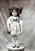 little girl dressed up in studio early 1900s