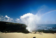 Blow hole spouting seawater, 27th May 1997, on Ascension, a small area of approximately 88 km² isolated volcanic island in the equatorial waters of the South Atlantic Ocean, roughly midway between the horn of South America and Africa. It is governed as part of the British Overseas Territory of Saint Helena, Ascension and Tristan da Cunha. Organised settlement of Ascension Island began in 1815, when the British garrisoned it as a precaution after imprisoning Napoleon I on Saint Helena. In January 2016 the UK Government announced that an area around Ascension Island was to become a huge marine reserve, to protect its varied and unique ecosystem, including some of the largest marlin in the world, large populations of green turtle, and the islands own species of frigate bird. With an area of 234,291 square kilometres 90,460 sq mi, slightly more than half of the reserve will be closed to fishing.