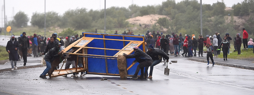 SOUTH AFRICA - Cape Town - 9 July  2020  - Police fire rubber bullets to disperse protesting Mfuleni residents and backyarders who were on the Hindle Road.They burnt tyres and rubble and blocked the road with bricks and rocks. Picture: Phando Jikelo/African News Agency(ANA)