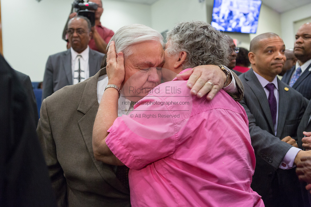 North Charleston Mayor Keith Summey is hugged following a healing service at Charity Missionary Baptist Church April 12, 2015 in North Charleston, South Carolina. The Rev. Al Sharpton spoke following the recent fatal shooting of unarmed motorist Walter Scott police and thanked the Mayor and Police Chief for doing the right thing in charging the officer with murder.