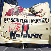Demonstrators gather around a monument during a May Day rally at Taksim square in central Istanbul May 1, 2010. More than 150,000 Turkish workers thronged a central Istanbul square on Saturday for May Day celebrations, held there for the first time since the late 1970s, when unknown gunmen massacred dozens of people. Photo by Aykut AKICI/TURKPIX