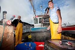 UK ENGLAND DEVON TEIGNMOUTH 10SEP16 - Fishermen Trevor Hall (50) and his son Brendon Hall (19) of Teignmouth land their catch at Teignmouth harbour, Devon, England.<br /> <br /> jre/Photo by Jiri Rezac<br /> <br /> © Jiri Rezac 2016